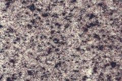 Granito grigio nero di superficie granulare, fondo di struttura immagini stock libere da diritti