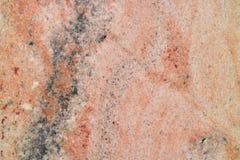 Granito rosado con una textura fina Foto de archivo