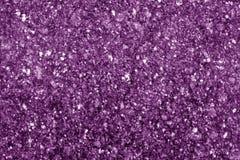 Granitoberfläche als Hintergrund im purpurroten Ton stockfoto