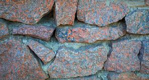 Granitowa kamiennej ściany tekstura z bliska obraz royalty free