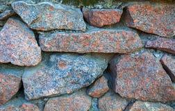 Granitowa kamiennej ściany tekstura z bliska obrazy royalty free