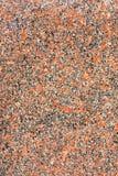 Granitsteinbeschaffenheiten als Hintergrund Rote Basis mit Schwarzem und Gray Spots lizenzfreies stockbild