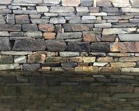 Granitziegelstein und Steinwand stockfoto