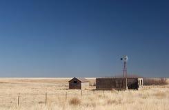 Granja abandonada en los altos llanos Foto de archivo libre de regalías