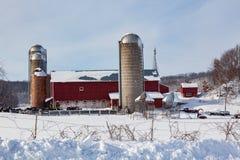 Granja lechera en nieve fresca Foto de archivo