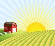 Granja y campos en la salida del sol