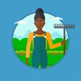 Granjero con el rastrillo en el campo de la col stock de ilustración