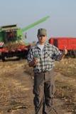 Granjero, dinero y cosecha, concepto agrícola Fotografía de archivo libre de regalías