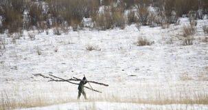 Granjero en nieve Imagen de archivo libre de regalías