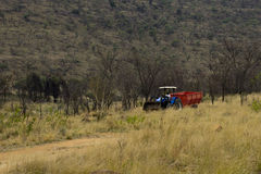 Granjero en un tractor Foto de archivo libre de regalías