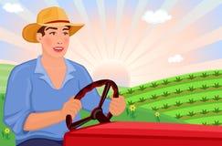 Granjero que conduce el alimentador en la granja Fotos de archivo