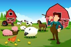 Granjero y tractor en una granja con los animales y el granero del campo Imagen de archivo