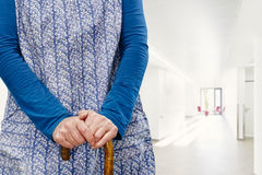 Granny apron hall klinik. Old woman with blue one gathers up and falter in the hall klinik Royalty Free Stock Photography