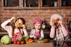 Granny with children at home kitchen stock photos