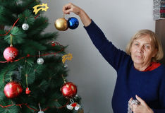 Granny with Christmas tree Royalty Free Stock Images