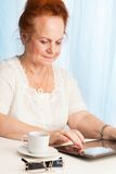 Granny exploring new gadget Royalty Free Stock Photos
