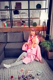 Granny and girl wearing pink bathrobes having beauty day at home stock photography