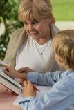 Granny and grandchild reading book Stock Image