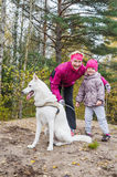 Granny with granddaughter and a dog walk in autumn Park Royalty Free Stock Photos