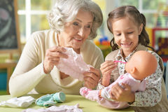 Granny with granddaughter playing together Royalty Free Stock Photos