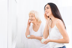 Granny, granddaughter taking care of themselves Stock Images