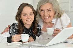 Granny with granddaughter using laptop Stock Images
