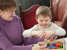 Granny and grandson Stock Image