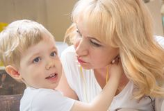 Granny grandson, both blonde kisses, cuddling and kissing. Stock Image