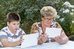 Granny with grandson watching tablet in nature Royalty Free Stock Photo