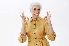 Granny has excellent health. Portrait of joyful active and emotive senior woman with white hair smiling joyfully and royalty free stock image