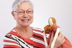 Granny holding rag doll smiling Royalty Free Stock Photo