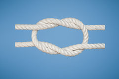 Granny Knot. The Granny Knot is a binding knot to secure a rope or line around an object Stock Photos