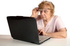 Granny with the laptop isolated on a white Royalty Free Stock Photography