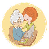 Granny learns the computer use with help of girl Stock Image