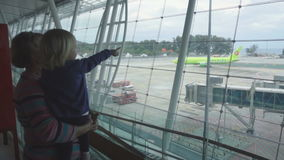 Granny with little girl at the airport stock video