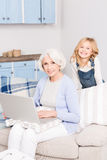 Granny and little girl using laptop Royalty Free Stock Image