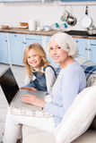 Granny and little girl using laptop Royalty Free Stock Photography