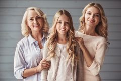 Granny, mom and daughter. Beautiful women generation: granny, mom and daughter are hugging, looking at camera and smiling royalty free stock photos