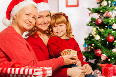 Granny and mother give presents to 3 years girl Royalty Free Stock Photos