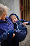 Granny with nephew. Happy grandmother holding nephew in her arms Stock Images