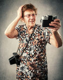 Granny photographer make selfie Stock Images