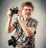 Granny photographer Stock Photo