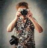 Granny photographer Royalty Free Stock Image