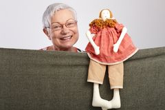 Granny presenting a puppet show Stock Image