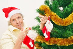 Granny in red Santa Claus hat and red socks Royalty Free Stock Photos