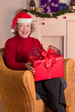 Granny Santa Claus hat gift Stock Images