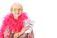 Granny showing off her lottery winnings. Isolated on white Royalty Free Stock Photos