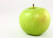 Granny Smith Apple. A fresh crisp Granny Smith apple isolated on a white background Royalty Free Stock Images
