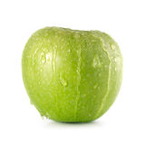 Granny Smith Apple. Green Granny Smith apple with water droplets running over it Isolated on white background Royalty Free Stock Image