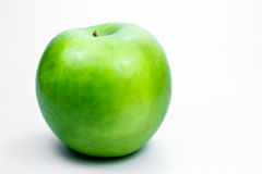 Granny smith apple. A green apple on a white background Royalty Free Stock Images